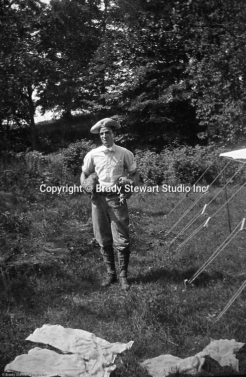 Gettysburg PA: View of Brady Stewart getting dinner ready while camping at Gettysburg. Brady Stewart was in Gettysburg with the Pittsburgh-area Boy's Brigade. They were in Gettysburg for the 40th anniversary of the battle of Gettysburg. The Boy's Brigade was a church-based youth organization started in the late 1800s in Scotland.