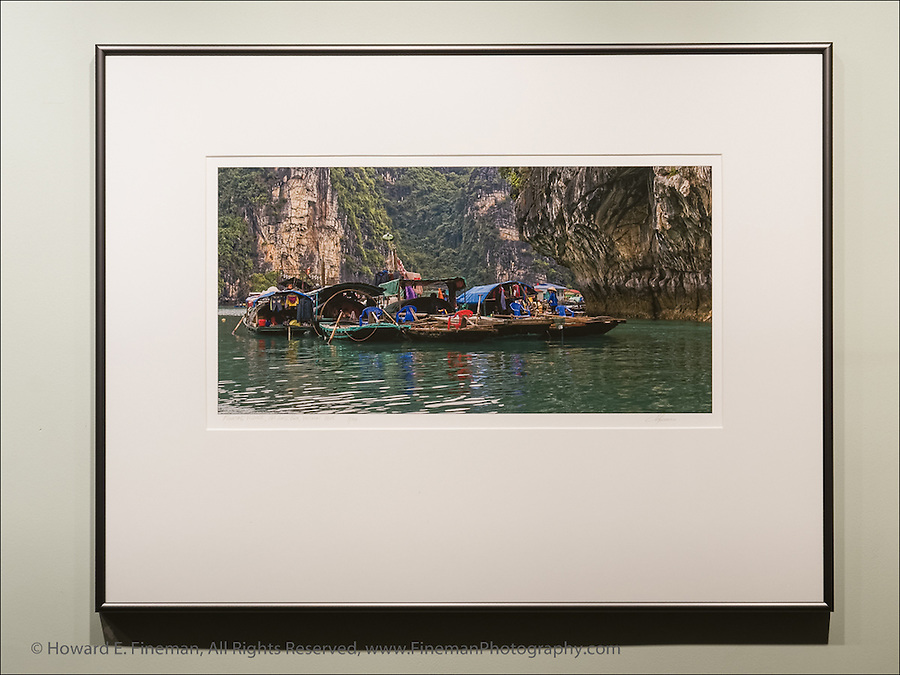 """Floating Village in Ha Long Bay in Gulf of Tonkin, Vietnam. This finished print shows how I typically mat and frame panoramic images. This print was selected for the Newton Open Studios """"Invitational"""" showcasing work of artists who previously received top juror awards."""