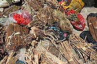 Bundles of dried roots at the Fuli Town Market used for traditional Chinese medicine, Fuli Village, Guangxi, China.