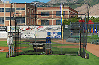 The batting cage is rolled off the field by the grounds crew as the Ogden Raptors face the Orem Owlz in Pioneer League play at Lindquist Field on August 28, 2013 in Ogden Utah.  (Stephen Smith/Four Seam Images)