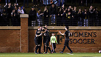 WINSTON-SALEM, NC - DECEMBER 01: Kyle Holcomb #3 of Wake Forest University is mobbed by teammates while celebrating his goal during a game between Michigan and Wake Forest at W. Dennie Spry Stadium on December 01, 2019 in Winston-Salem, North Carolina.
