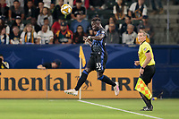 CARSON, CA - SEPTEMBER 21: Bacary Sagna #33 of the Montreal Impact leaps high for a ball during a game between Montreal Impact and Los Angeles Galaxy at Dignity Health Sports Park on September 21, 2019 in Carson, California.