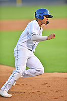 Asheville Tourists Yainer Diaz (16) rounds third base during a game against the Greensboro Grasshoppers on August 24, 2021 at McCormick Field in Asheville, NC. (Tony Farlow/Four Seam Images)