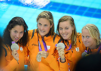 July 28, 2012: Ranomi Kromowidjojo, Marleen Veldhuis, Femke Heemskerk and Inge Dekker of the Netherlands pose with women's 4x100 meter Freestyle Relay Silver Medal at the Aquatics Center on day one of 2012 Olympic Games in London, United Kingdom.