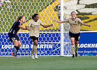 Marta (10) of FC Gold Pride celebrates the goal of teammate Tiffeny Milbrett (15) as Cat Whitehill (4) of the Washington Freedom disputes the call during the game at the Maryland SoccerPlex in Boyds, Maryland. FC Gold Pride defeated the Washington Freedom, 4-1.