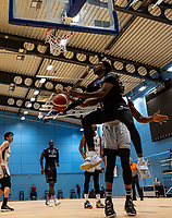 Tony Hicks of Surrey Scorchers drives under the basket during the BBL Championship match between Surrey Scorchers and Newcastle Eagles at Surrey Sports Park, Guildford, England on 20 March 2021. Photo by Liam McAvoy.