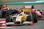 05 Apr 2009, Kuala Lumpur, Malaysia --- ING Renault F1 Team driver Fernando Alonso of Spain steers his car folowed by Scuderia Ferrari Marlboro driver Kimi Raikkonen of Finland during the 2009 Fia Formula One Malasyan Grand Prix at the Sepang circuit near Kuala Lumpur. Photo by Victor Fraile --- Image by © Victor Fraile / The Power of Sport Images