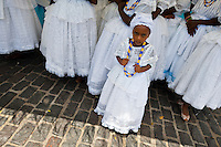 A young Baiana girl seen during the ritual ceremony in honor to Yemanjá, the Candomblé goddess of the sea, in Cachoeira, Bahia, Brazil, 5 February 2012. Yemanjá, originally from the ancient Yoruba mythology, is one of the most popular ?orixás?, the deities from the Afro-Brazilian religion of Candomblé. Every year on February 5th, hundreds of Yemanjá devotees participate in a colorful celebration in her honor. Faithful, usually dressed in the traditional white, gather on the banks of Paraguaçu river to leave offerings for their goddess. Gifts for Yemanjá include flowers, perfumes or jewelry. Dancing in the circle and singing ancestral Yoruba prayers, sometimes the followers enter into a trance and become possessed by the spirits. Although Yemanjá is widely worshipped throughout Latin America, including south of Brazil, Uruguay, Cuba or Haiti, the most popular cult is maintained in Bahia, Brazil.