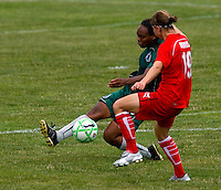 St. Louis Athletica defender Kia McNeill (6) and Washington Freedom midfielder Rebecca Moros (19) during a WPS match at Anheuser-Busch Soccer Park, in Fenton, MO, June 20 2009. Washington  won the match 1-0.