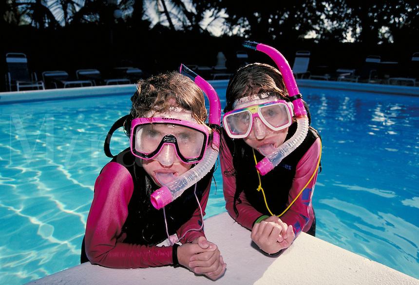 Children in diving gear snorkeling at poolside. Children. Douglaston NY.