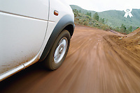 New Caledonia, Grand Terre Island, car on road (blurred motion) (Licence this image exclusively with Getty: http://www.gettyimages.com/detail/200337511-001 )