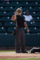 Home plate umpire Hector Cuellar makes a strike call during the game between the Hickory Crawdads and the Winston-Salem Dash at Truist Stadium on July 10, 2021 in Winston-Salem, North Carolina. (Brian Westerholt/Four Seam Images)