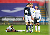 3rd October 2020; Liberty Stadium, Swansea, Glamorgan, Wales; English Football League Championship, Swansea City versus Millwall; Scott Malone of Millwall and Jay Fulton of Swansea City go head to head after a foul on Andre Ayew of Swansea City
