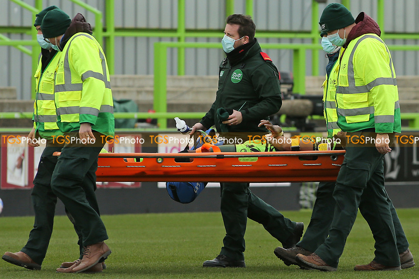 Forest Green Rovers's Jamille Matt is stretchered off after suffering a nasty hand injury during Forest Green Rovers vs Bolton Wanderers, Sky Bet EFL League 2 Football at The New Lawn on 27th March 2021