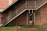 December 22, 2014. Lexington, North Carolina.<br />  Mayor Newell Clark uses a factory staircase for pull-ups as part of his exercise routine with local citizens.<br />   Newell Clark, the 43 year old mayor of Lexington, NC, leads a group of friends and colleagues on a 4 times a week exercise routine around downtown. The group uses existing infrastructure, such as an abandoned furniture factory, loading docks, stairs, and handrails to get fit and increase awareness of healthy lifestyles in a town more known for BBQ.<br /> Jeremy M. Lange for the Wall Street Journal<br /> Workout_Clark