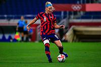 SAITAMA, JAPAN - JULY 24: Julie Ertz #8 of the United States passes the ball during a game between New Zealand and USWNT at Saitama Stadium on July 24, 2021 in Saitama, Japan.