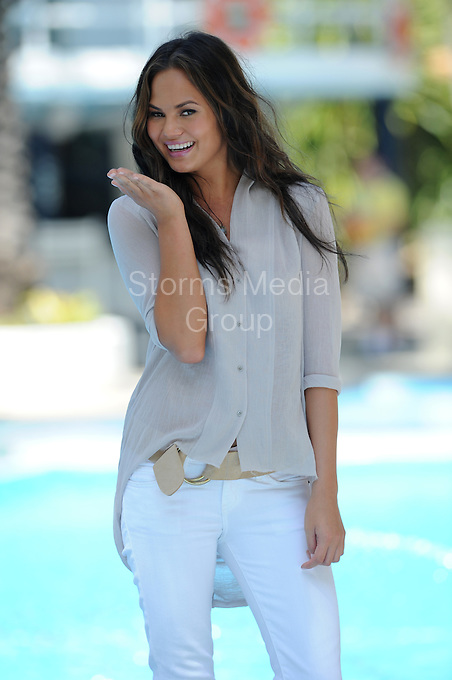SMG_Chrissy Teigen_Raleigh Pool_071411_17.JPG<br /> <br /> MIAMI BEACH, FL - JULY 14:  John Legend's girlfriend, supermodel Chrissy Teigen poses poolside at The Raleigh Hotel prior to the start of Miami Swim Week 2011.  Christine Teigen (born November 30, 1985), also known as Chrissy Teigen, is an American model of Thai-Norwegian ancestry. She made her rookie debut in the annual Sports Illustrated Swimsuit Issue in 2010. She is from the small town of Snohomish, Washington. On July 14, 2011 in Miami Beach, Florida,  (Photo By Storms Media Group)<br />  <br /> People:   Chrissy Teigen<br /> <br /> Must call if interested<br /> Michael Storms<br /> Storms Media Group Inc.<br /> 305-632-3400 - Cell<br /> 305-513-5783 - Fax<br /> MikeStorm@aol.com