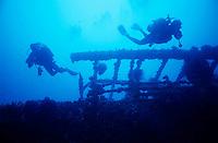 Scuba divers exploring a shipwreck.