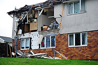 Pictured: The damaged building in the Waunceirch area of Neath, Wales, UK. Tuesday 15 January 2018<br /> Re: Four flats have been evacuated after an explosion in Neath at 8:30pm on Monday.<br /> Extensive damage was caused to Waun Las, in the Waunceirch area and arrangements made to house its residents until the building is deemed safe.<br /> One woman was taken to hospital with serious burn injuries which are not believed to be life threatening.<br /> A joint investigation is under way between South Wales Police and the fire service to determine the cause.<br /> Wales and West Utilities said the gas supply to the affected property had been isolated.