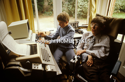 Professor Stephen Hawking 1981 at home Cambridge UK 1980s with young family.   Seen here with eldest son Robert.