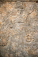 Assyrian relief sculpture panel  of a female protective spirit  from Nimrud, Iraq.  865-860 B.C North West Palace, Room I.  British Museum Assyrian  Archaeological exhibit  ref WA 124581