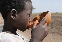 TANZANIA girl drinks water from calabash in Meatu district / TANSANIA Meatu , Maedchen trinkt Wasser aus Kalabasse