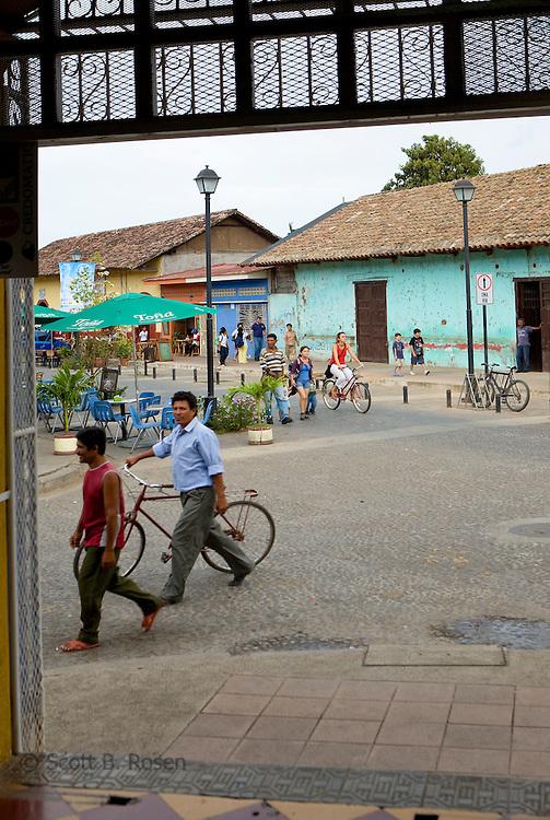 Looking through a shop door onto the busy Calle La Calzada, Granada, Nicaragua