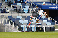 SAINT PAUL, MN - MAY 12: Jukka Raitala #22 of Minnesota United FC and Lucas Cavallini #9 of Vancouver Whitecaps FC battle for the ball during a game between Vancouver Whitecaps and Minnesota United FC at Allianz Field on May 12, 2021 in Saint Paul, Minnesota.