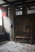 A corner of the ancient banqueting hall displays a faded array of antiques, including a tapestry, a fraying flag and a spear and breastplate, long since redundant but now a valued reminder of less peaceful times