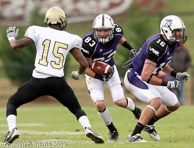 ROME, GA - DECEMBER 19:  Jon Ryan #83 of the University of Sioux Falls looks to gain extra yards as teammate Brad Theilen #16 prepares to block and Hakim Thomas #15 of Lindenwood University defends in the first half of the NAIA Championship game Saturday afternoon at Barron Stadium in Rome, GA. (Photo by Dave Eggen/Inertia)