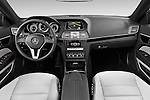 Stock photo of straight dashboard view of2013 Mercedes Benz E Class 220 2 Door Coupe Dashboard