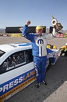 Apr. 7, 2013; Las Vegas, NV, USA: NHRA pro stock driver Allen Johnson celebrates after winning the Summitracing.com Nationals at the Strip at Las Vegas Motor Speedway. Mandatory Credit: Mark J. Rebilas-