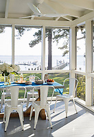 In the porch, weather resistant furniture is ideal, so a zinc-topped table with a cedar base is paired with Xavier Pauchard style chairs made of powder-coated aluminium, an electrostatic finish that's hardier than paint.