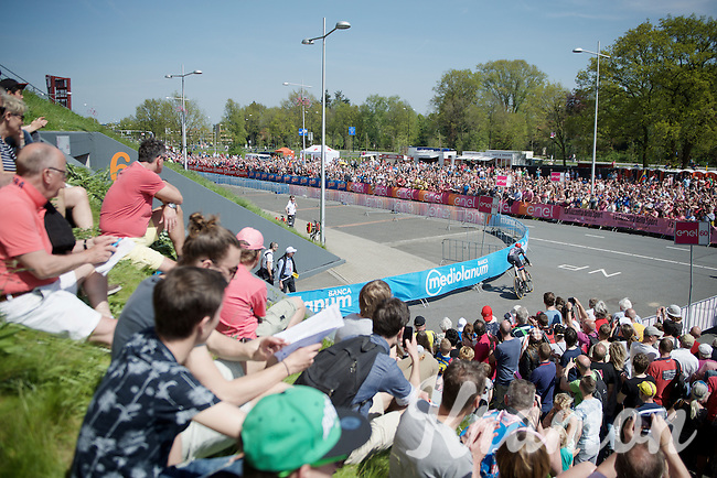 thick crowds cheer for riders coming out of the Apeldoorn velodrome (where the start podium stands)<br /> <br /> stage 1: Apeldoorn prologue 9.8km<br /> 99th Giro d'Italia 2016