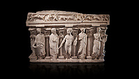 "Roman relief sculpted sarcophagus with kline couch lid, ""Columned Sarcophagi of Asia Minor"" style typical of Sidamara, 3rd Century AD, Konya Archaeological Museum, Turkey. Against a black background"