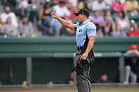 Umpire Ray Valero works a game between the Greensboro Grasshoppers and the Greenville Drive on Saturday, July 24, 2021, at Fluor Field at the West End in Greenville, South Carolina. (Tom Priddy/Four Seam Images)