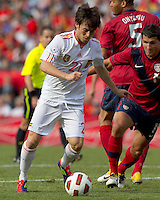 Spain forward David Silva (21) dribbles as USA defender   Eric Lichaj (14) defends. In a friendly match, Spain defeated USA, 4-0, at Gillette Stadium on June 4, 2011.