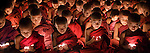 """""""Enlightenment""""<br /> Young Buddhist novices meditate in the predawn hours at Mahagandayon Monastery, Myanmar."""