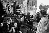 Los Angeles, California.USA.March 17, 2007..Through the window of a café at Hollywood and Vine thousands of people march down Hollywood Boulevard to protest the fourth anniversary of the war in Iraq.