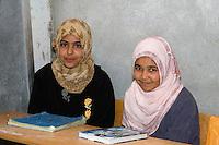 Surman, Libya.  Girls in the Madrasa of Sidi Rashid al-Galili, after reciting a portion of the Koran.  Young girls wear the traditional Libyan head scarf.