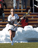 Boston College midfielder Sarah Mannelly (6) brings the ball forward. .Boston College (white) defeated Boston University (red), 12-9, on the Newton Campus Lacrosse Field at Boston College, on March 20, 2013.