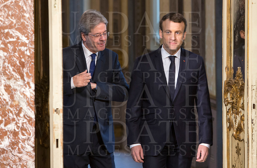 Italian Premier Paolo Gentiloni, left, and French President Emmanuel Macron arrive for a joint press conference at the end of their talks at Chigi Palace in Rome, January 11, 2018.<br /> UPDATE IMAGES PRESS/Riccardo De Luca<br /> <br /> ITALY OUT
