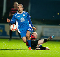 Ayr Utd's Robbie Crawford makes a lunge at Queen of the South's Daniel Carmichael.