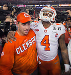 Clemson head coach Dabo Swinney and quarterback Deshaun Watson walk off the field after defeating Alabama for the 2017 College Football Playoff National Championship in Tampa, Florida on January 9, 2017.  Clemson defeated Alabama 35-31. Photo by Mark Wallheiser/UPI