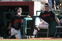 SCOTTSDALE, AZ - MARCH 9:  Aaron Rowand of the San Francisco Giants (left) blows a bubble and talks with Giants manager Bruce Bochy during a spring training game against the Colorado Rockies at Scottsdale Stadium in Scottsdale, Arizona on March 9, 2008. Photo by Brad Mangin