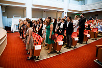 Contestants stand after walking in a processional into Auer Hall during the opening ceremony of the 11th USA International Harp Competition at Indiana University in Bloomington, Indiana on Wednesday, July 3, 2019. (Photo by James Brosher)