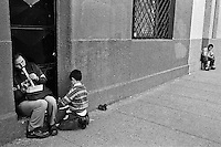 A blind man, accompanied by his son, plays flute on the street of Santiago de Chile, Chile, 15 April 2002.