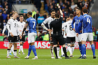 Referee Tony Harrington shows a yellow card to Ben Cabango of Swansea City during the Sky Bet Championship match between Cardiff City and Swansea City at the Cardiff City Stadium, Cardiff, Wales, UK. Sunday 12 January 2020