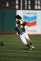 OAKLAND, CA - SEPTEMBER 25:  Tony Kemp #5 of the Oakland Athletics catches a fly ball in left field against the Houston Astros during the game at the Oakland Coliseum on Saturday, September 25, 2021 in Oakland, California. (Photo by Brad Mangin)