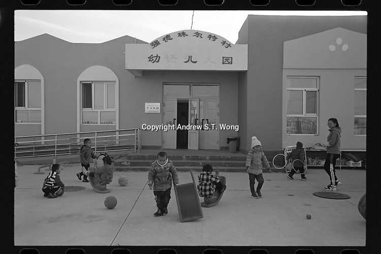 Jeminay County, Xinjiang Uygur Autonomous Region, China - Students play at a nursery, October 2019.